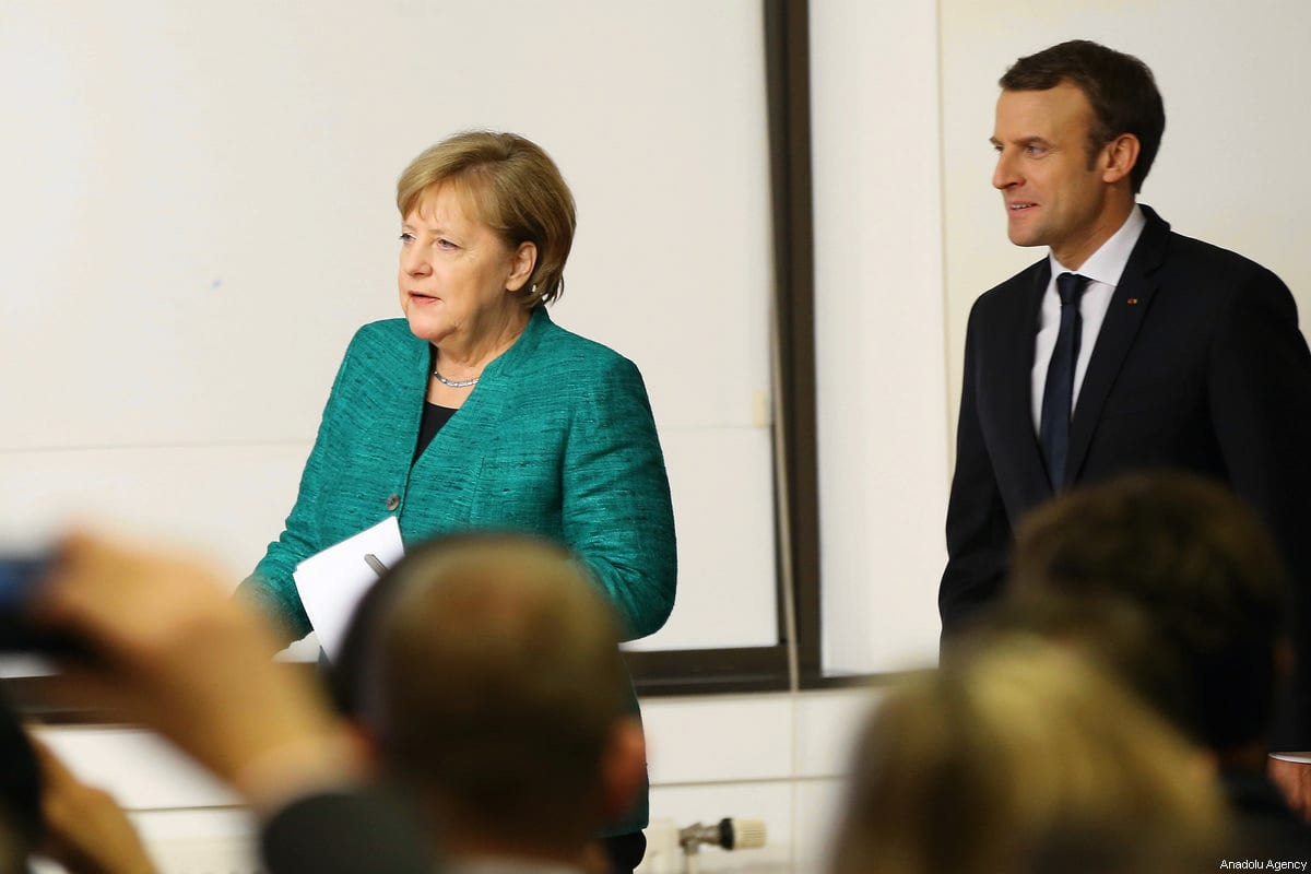 German Chancellor Angela Merkel (L) and French President Emmanuel Macron (R) hold a joint press conference as they attend the European Summit of the Heads of State and Government of the European Union in Brussels, Belgium on December 15, 2017 [Dursun Aydemir / Anadolu Agency]