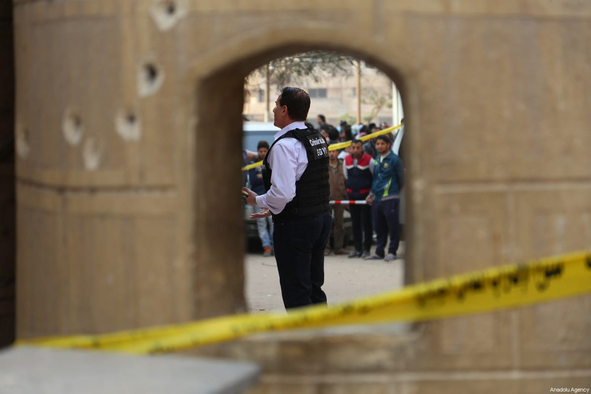 Security forces inspect the scene after an armed attack by unknown assailants to Marminna Church in Cairo's southern Helwan district in Cairo, Egypt on December 29, 2017 [Stringer / Anadolu Agency]