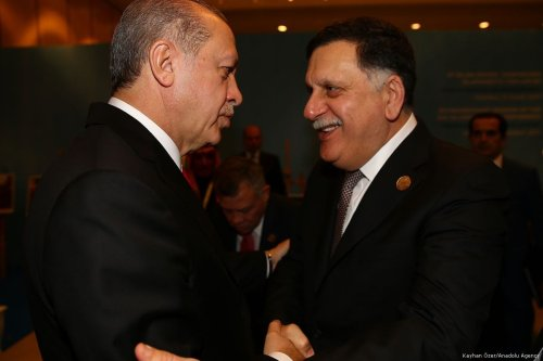 Turkish President Recep Tayyip Erdogan (L) meets with Chairman of the Presidential Council of Libya and Prime Minister of the Government of National Accord of Libya Fayez al-Sarraj (R) within the extraordinary summit of the Organisation of Islamic Cooperation (OIC) in Istanbul, Turkey on 13 December, 2017 [Kayhan Özer/Anadolu Agency]
