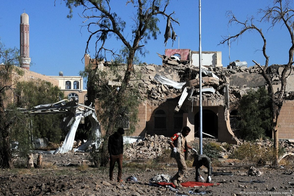 Yemenis remove the bodies of those killed in a Saudi-led coalition air strike in Yemen on 13 December 2017 [Mohammed Hamoud/Anadolu Agency]