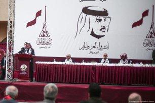 Chairman of the Qatari Committee for the Reconstruction of Gaza Ambassador Mohammed Al-Emadi (L) makes a speech in Khan Yunis, Gaza on 19 December 2017 [Mustafa Hassona/Anadolu Agency]