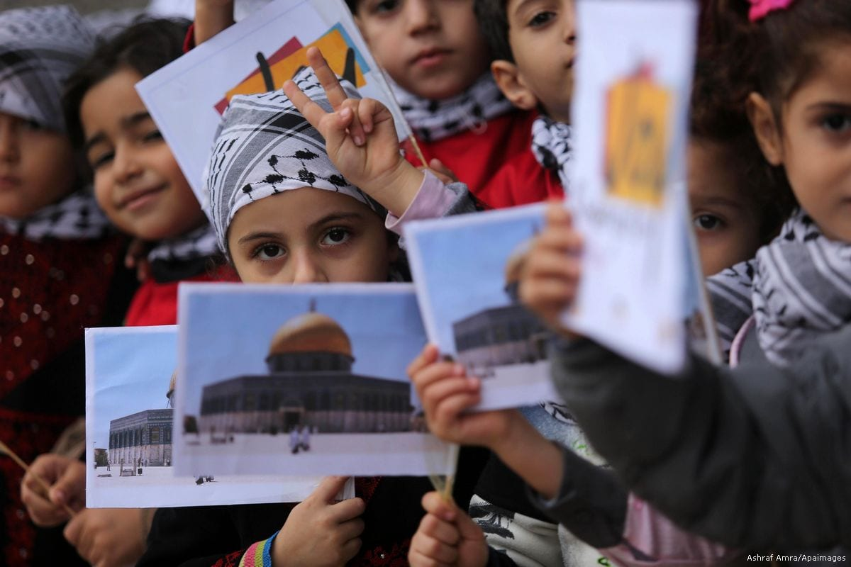 Palestinian children hold pictures of Jerusalem during a protest against Trump's decision to move the US embassy from Tel Aviv to Jerusalem in Gaza city, on 6 December 2017 [Ashraf Amra/Apaimages]