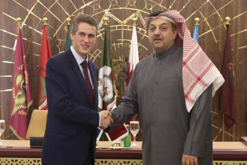 Defence Secretary of United Kingdom, Gavin Williamson (L) shakes hands with Minister of State for Defense of Qatar Khalid bin Mohammad Al Attiyah (R) after signing an agreement on the sale of Eurofighter Typhoon type jet fighters to Qatar following a meeting in Doha, Qatar on 10 December, 2017 [Defence Ministry of Qatar - Handout/Anadolu Agency]