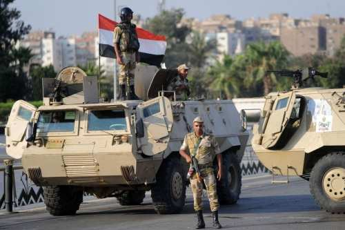 Egyptian security forces seen in Arish, following an attack which was claimed by Daesh, on 19 December 2017 [Anadolu Agency]