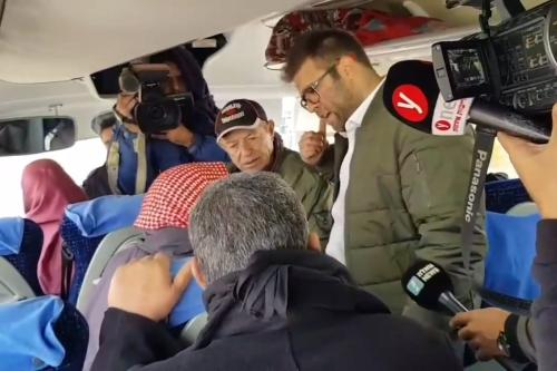 Israeli lawmaker Oren Hazan boards a bus at the Gaza-Israel border which was taking families of Palestinian prisoners to visit them, on December 25, 2017 [screengrab]