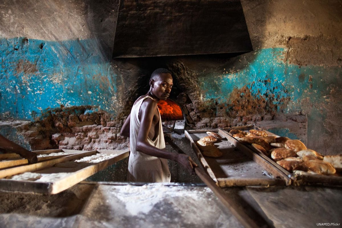A Sudanese baker prepares bread in North Darfur, Sudan [UNAMID/Flickr]