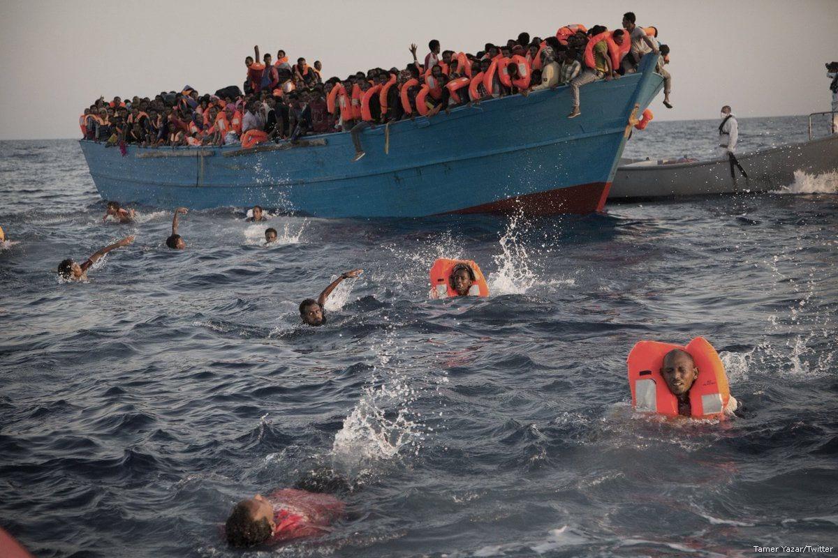 Migrants swim to safety after travelling on the Mediterranean sea, seen on August 30, 2016 [Tamer Yazar/Twitter]
