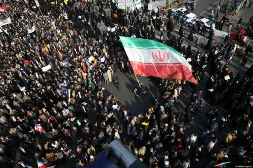 Thousands of Iranians hold banners and posters as they take part in a pro-government rally in Mashhad, Iran on January 4, 2018 [Nima Najafzadeh / Anadolu Agency]