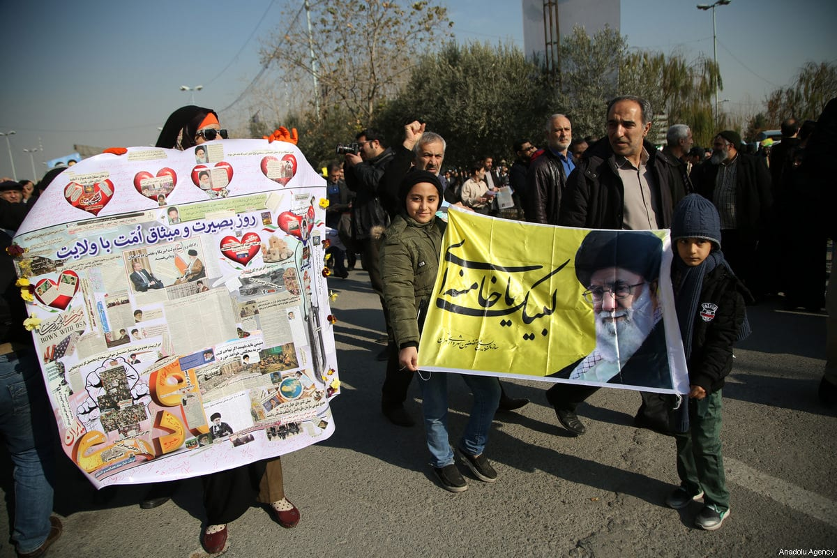 Iranians hold placards during a protest after performing the Friday Prayer at Imam Khomeini Mosque following US' statement about backing the anti-government protests in Tehran, Iran on 5 January, 2018 [Fatemeh Bahrami/Anadolu Agency]