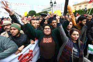 People shout slogans during a protest against new budget law and price hikes as they march to the governorship building in Tunis, Tunisia on January 12, 2018 [Yassine Gaidi / Anadolu Agency]