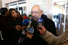 Leader of the En-Nahda Movement Rached Ghannouchi (C) speaks to media after a meeting with political parties, unions and employers on January 13, 2018 in Tunis, Tunisia following unrest triggered by austerity measures [Yassine Gaidi / Anadolu Agency]
