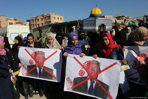 Palestinians protest against US President Donald Trump's decision to recognise Jerusalem as the capital of Israel in Gaza city on 8 January 2018 [Ashraf Amra/Apaimages]