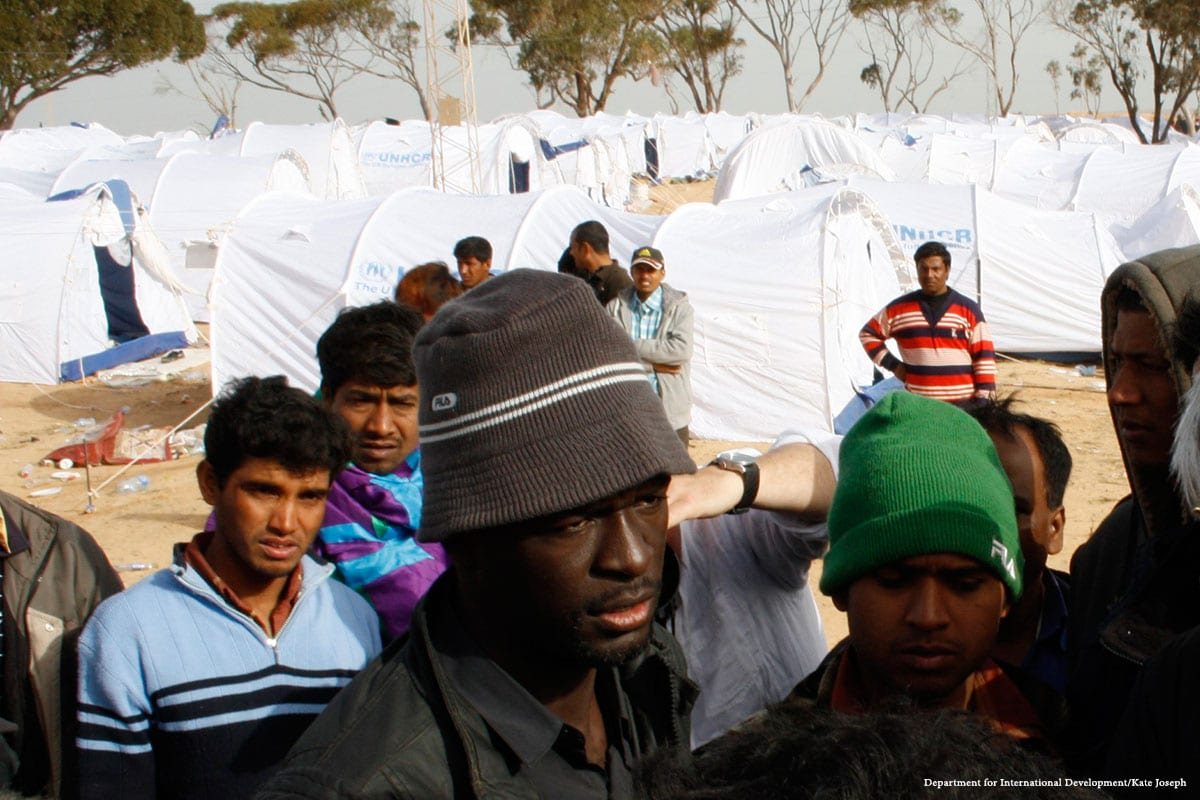Migrants can be seen at a shelter in Libya [Department for International Development/Kate Joseph]