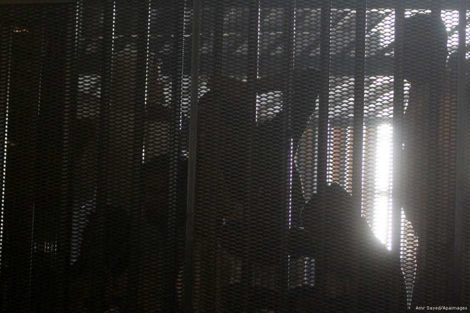 Egyptian prisoners can be seen behind bars [Amr Sayed/Apaimages]
