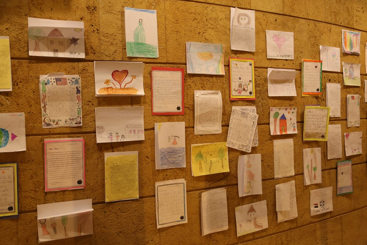 Letters and drawings between young Syrian refugees in Lebanon and kids in New York on display in Beirut, Lebanon, February 16, 2018. Thomson Reuters Foundation/Heba Kanso.