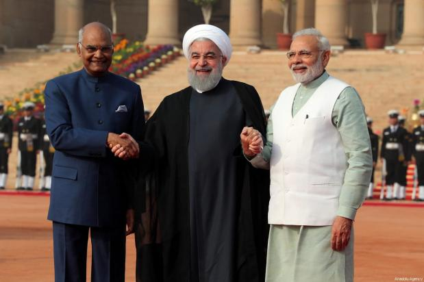 Indian President Ram Nath Kovind (R) and Prime Minister Narendra Modi (L) welcome Iranian President Hassan Rouhani (C) during an official welcoming ceremony in New Delhi, India on February 17, 2018 [Iranian Presidency / Handout / Anadolu Agency]