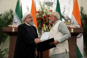 Indian Prime Minister Narendra Modi (R) shakes hands with Iranian President Hassan Rouhani (L) after signing a cooperation agreement between India and Iran in New Delhi, India on February 17, 2018 [Iranian Presidency / Handout / Anadolu Agency]