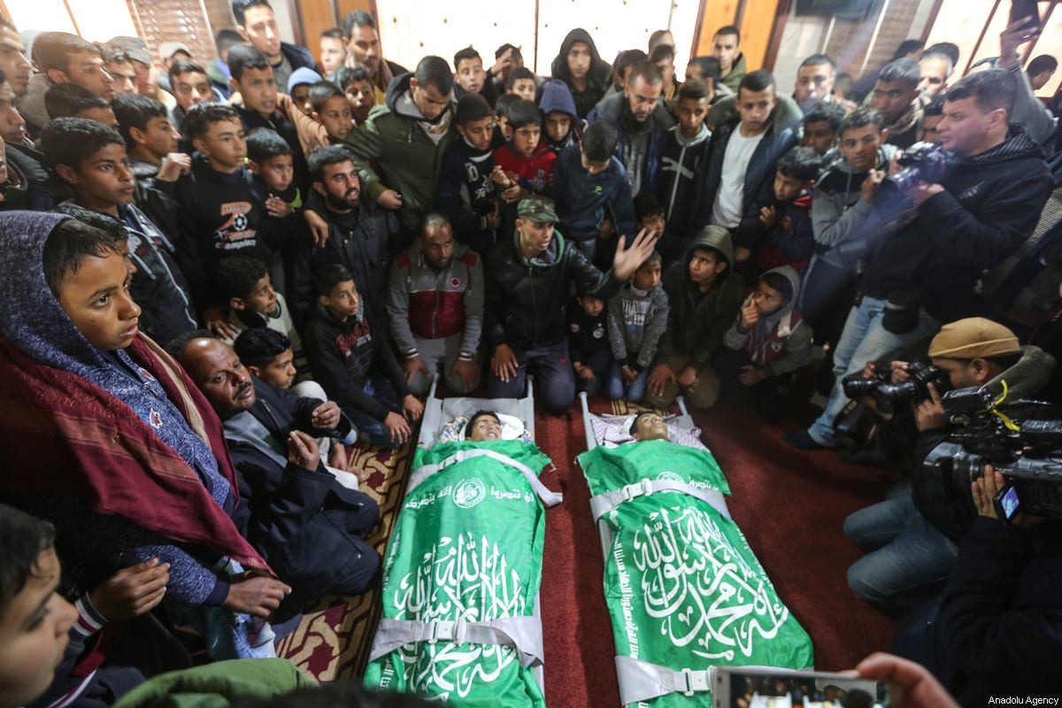 People attend the funeral ceremony of 17-years-old youths Salim Sabah (C-L) and Abdullah Abu Sheyha (C-R), who were killed in Israeli warcraft and howitzer attacks, in Rafah, Gaza on February 18, 2018 [Mustafa Hassona / Anadolu Agency]