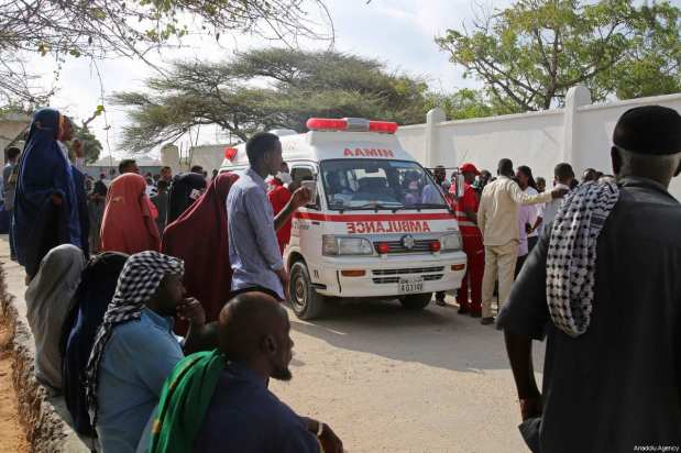 An ambulance carrying the body of the victims is seen after two attacks carried out bomb-laden vehicles near Somalian National Intelligence and Security Agency (NISA) building in Mogadishu, Somalia on February 24, 2018 [Sadak Mohamed / Anadolu Agency]