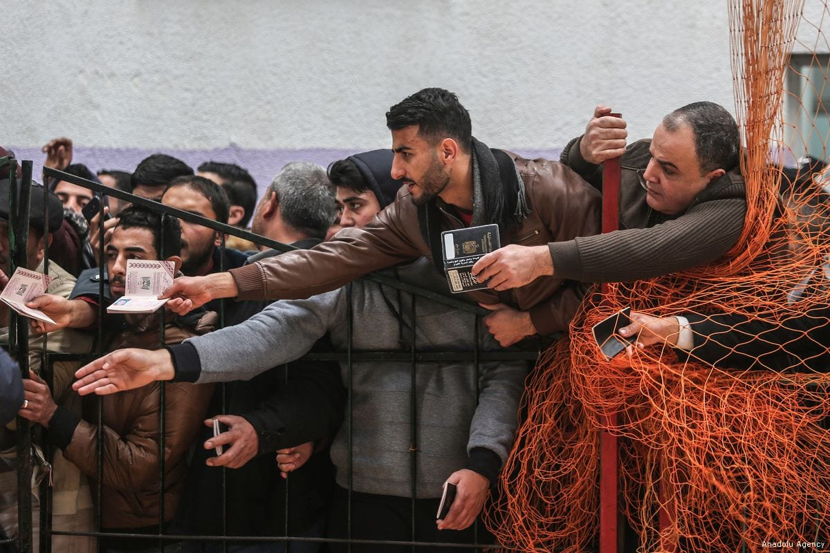 Gazans wait for a bus, which will transport them to Egypt, after Egyptian authorities opened the Rafah border gate on 8 February 2018 [Ali Jadallah/Anadolu Agency]