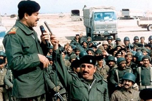 Saddam Hussein and his troops during the First Gulf War in 1991 [Wikipedia]