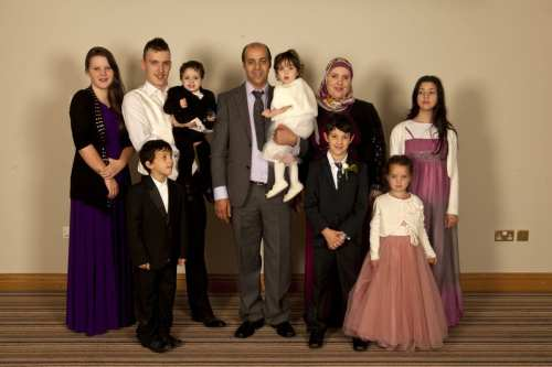 Gina Davis, along with her now estranged husband Kamel Fekkar, seen with their 8 children [Image: Gina Davis]