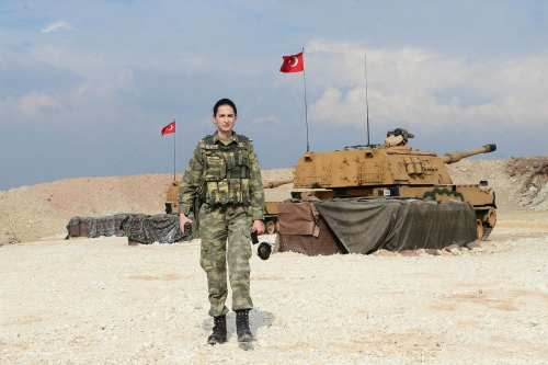 """An artillery captain Dilek Aygun poses for a photo as she takes part in the Turkish military's """"Operation Olive Branch"""" in Afrin, Syria on February 27, 2018 [Soner Kılınç / Anadolu Agency]"""