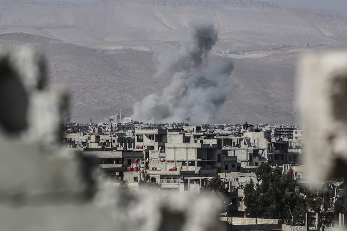 Smoke rises after the Assad Regime carried out air strikes in eastern Ghouta, Syria on 5 March 2018 [Mouneb Taim/Anadolu Agency]