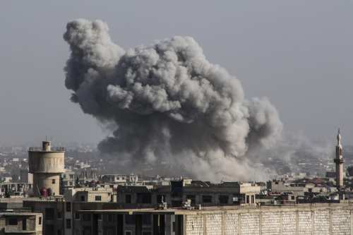 Smoke rises after Assad Regime's airstrike hit residential areas in Eastern Ghouta despite decisions to implement a ceasefire made separately by Russia and the UN Security Council, in Damascus, Syria on March 05, 2018 [Diaa Al-Din Samout / Anadolu Agency]