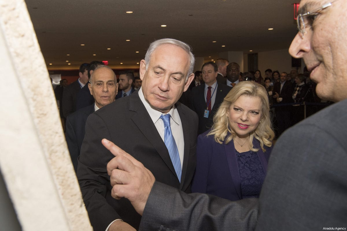 "Israel's Prime Minister Benjamin Netanyahu, seen with his wife Sara Nethanyahu, speaks as he visits the exhibition titled ""3000 years of history: Jews in Jerusalem"" at United Nations headquarters, Thursday, March 8, 2018 [UN Photo/Eskinder Debebe/Handout - Anadolu Agency]"
