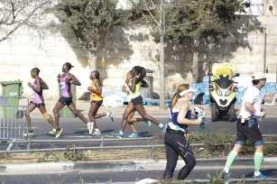 Participants compete during the 8th annual International Jerusalem Marathon in Jerusalem on March 09, 2018 [Mostafa Alkharouf / Anadolu Agency]