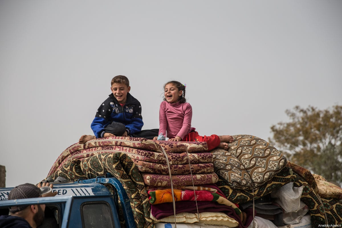 "Syrian children are seen on a pick up truck with their family's belongings as they return to their homes Afrin and Idlib, after Turkish Armed Forces and Free Syrian Army (FSA) took complete control of northwestern Syria's Afrin from PKK/KCK/PYD-YPG and Daesh terror groups within the ""Operation Olive Branch"" on March 24, 2018. ( Halil Fidan - Anadolu Agency )"