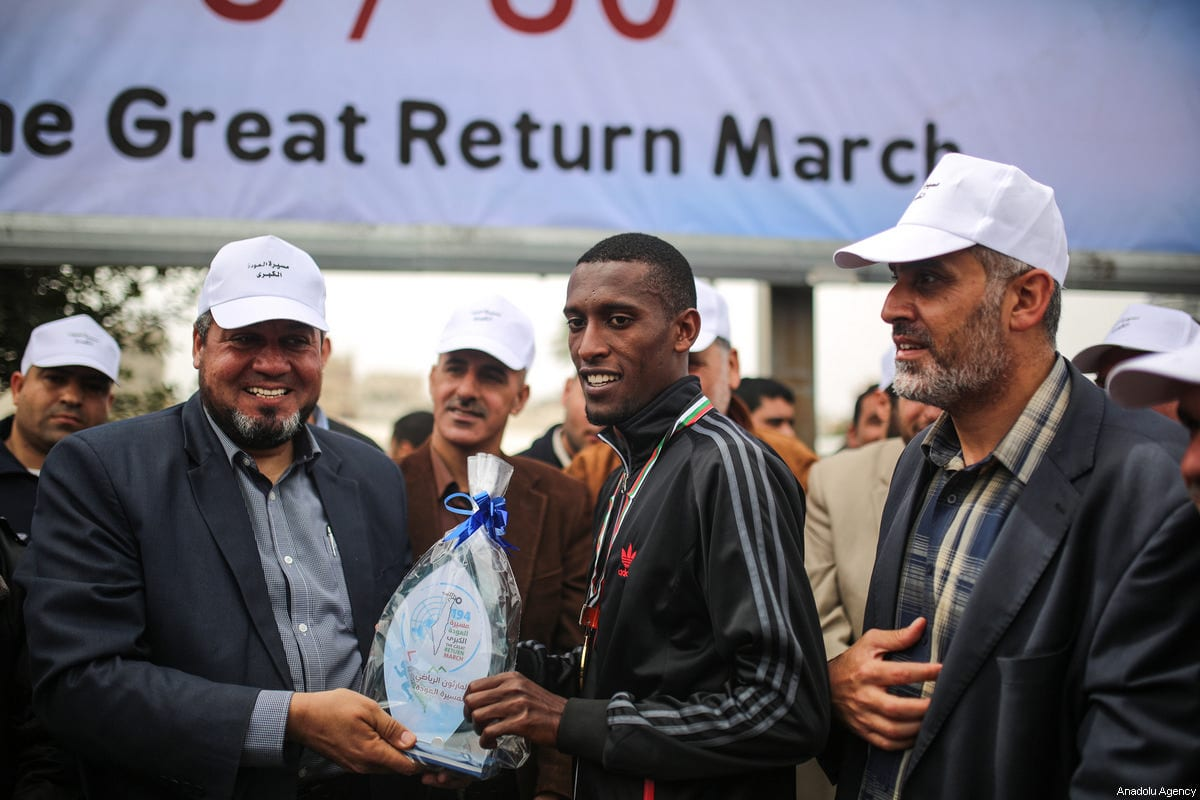 "Palestinian winner Yousuf Ubeyd (C) receives his present at the end of a mass march that held for the ""Great Return March"" in Gaza City, Gaza on 24 March, 2018 [Mustafa Hassona/Anadolu Agency]"