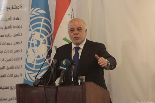 Former Iraqi Prime Minister Haidar Al-Abadi delivers a speech during a conference in Mosul, Iraq on 14 March 2018 [Yunus Keleş/Anadolu Agency]