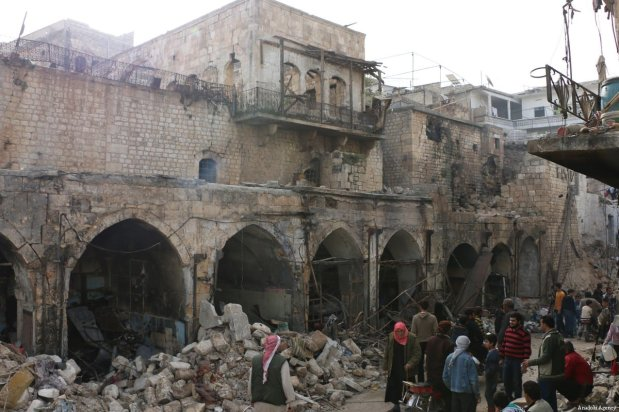 Heavily damaged buildings are seen at a marketplace after the Assad Regime carried out air strikes in Idlib, Syria on 23 March 2018 [Ahmed Rahhal/Anadolu Agency]