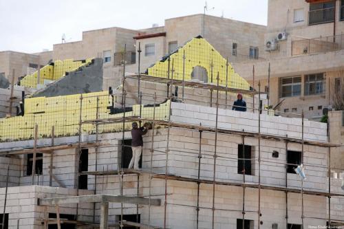 build illegal settlements in East Jerusalem [Sliman Khader/Apaimages]
