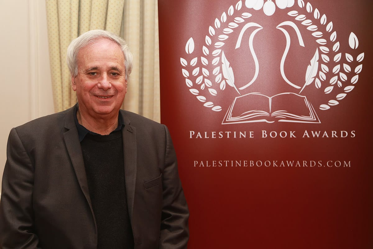 """Ilan Pappe, winning author of the Lifetime Achievement Award for his """"The Biggest Prison on Earth"""" at the Palestine Book Awards, 2017 on 24 November, 2017 [Middle East Monitor]"""