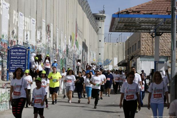 Runners take part in the 6th International Palestine Marathon in Bethlehem, West Bank on 23 March 2018 [Wisam Hashlamoun/Anadolu Agency]
