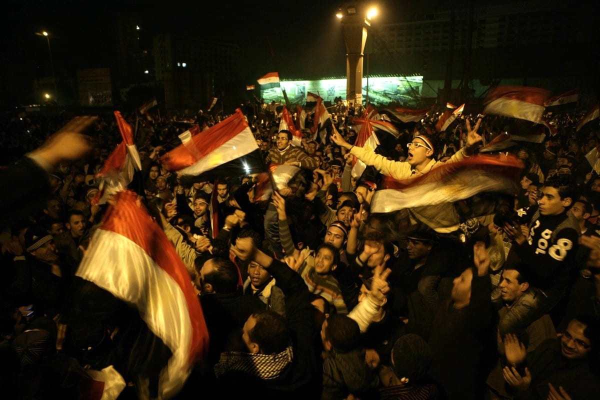 Egyptians celebrate the news that Hosni Mubarak has resigned amidst the 2011 revolution