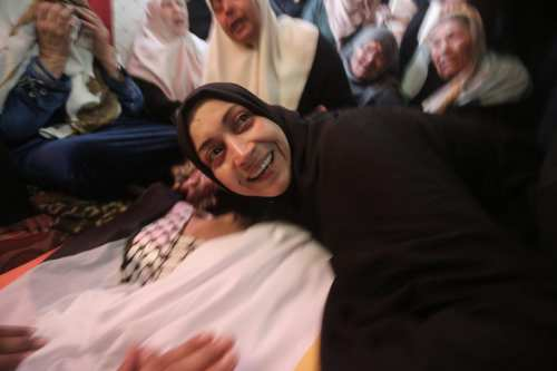 Mother of Palestinian fisherman Ismail Abu-Riyaleh, 18, receives his body from Israel on March 15, 2018. Abu-Riyaleh was killed after the Israeli navy opened fired on the boat he and two others were sailing on February 25, 2018 [Mohammad Asad / Middle East Monitor]