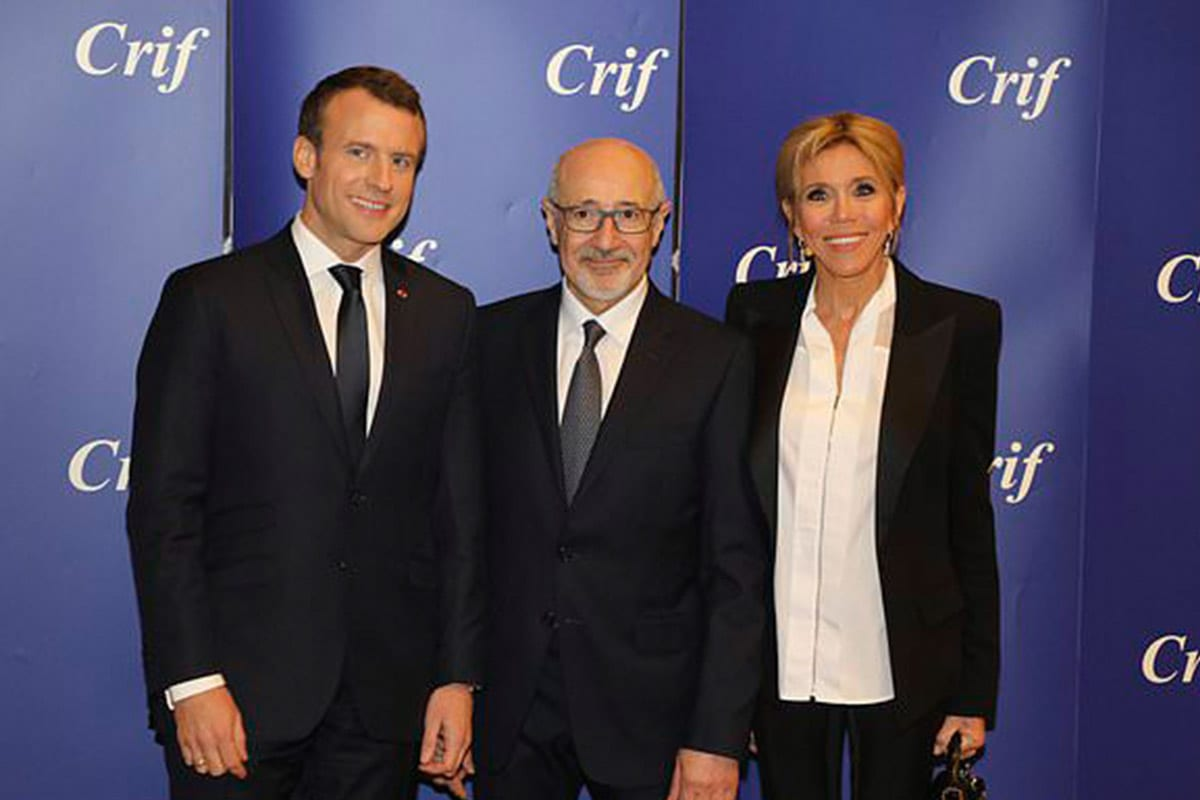 CRIF president Francis Kalifat,(C), with French President Emmanuel Macron (L) and his wife Brigitte Macron (R) during the annual CRIF dinner [Anadolu Agency]