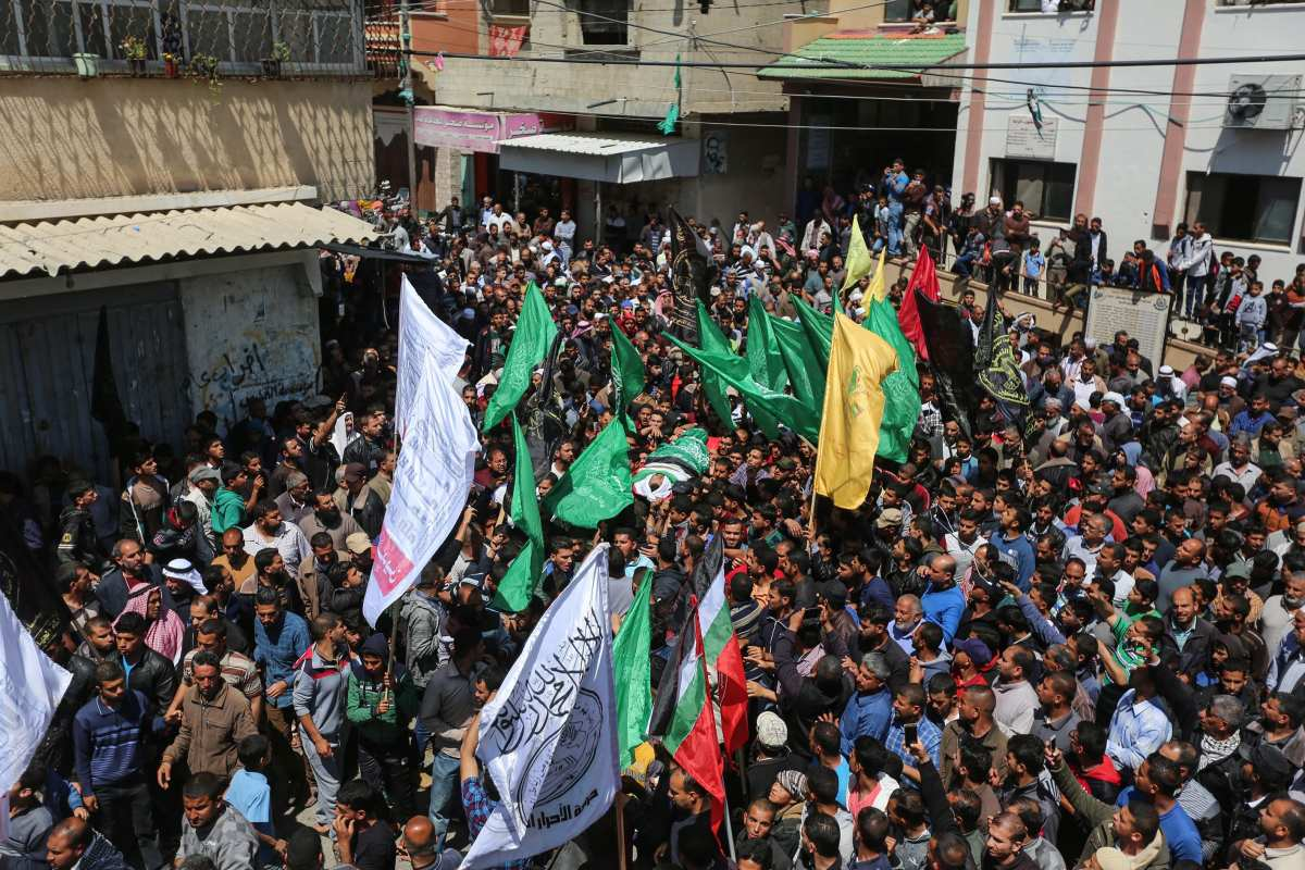 """Palestinians attend the funeral ceremony of Marwan Kadeh, who was murdered by Israeli soldiers during """"Great March of Return"""" near Gaza-Israel border, at Al-Taqwa Mosque in Khoza'a town of Khan Yunis, Gaza on 9 April, 2018 [Mustafa Hassona/Anadolu Agency]"""