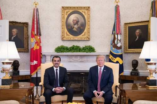 Qatari Emir Tamim Bin Hamad Al Thani (L) and US President Donald Trump (R) during their meeting in the Oval Office at the White House in Washington, United States on 10 April 2018. [Qatar News Agency/Handout]
