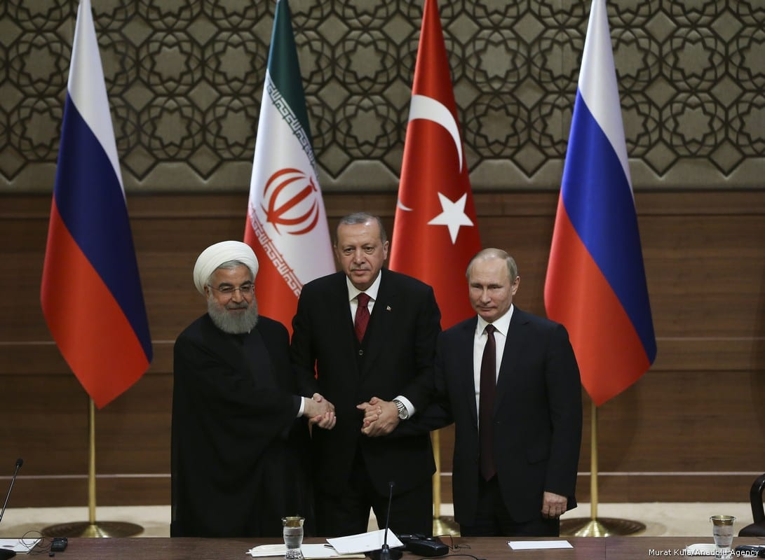 Turkish President Recep Tayyip Erdogan (C), Russian President Vladimir Putin (R) and President of Iran, Hassan Rouhani (L) hold a joint press conference following the Turkey-Russia-Iran Tripartite summit in Ankara, Turkey on 4 April, 2018 [Kayhan Özer/Anadolu Agency]