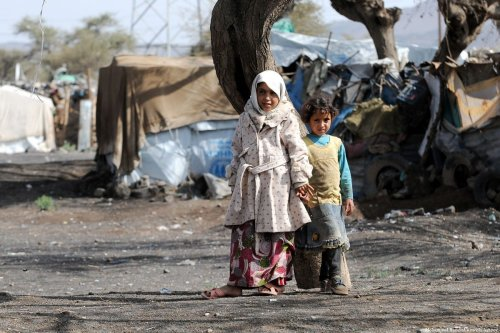 Children are seen in front of makeshift tents at Darwan refugee camp in Amran north of Sana'a, Yemen on 11 April 2018 [Mohammed Hamoud/Anadolu Agency]