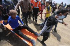 An injured Palestinian protester is seen on a stretcher after Israeli forces fired at protesters during the 'Great March Of Return' on 6th April 2018 [Mohammed Asad/Middle East Monitor]