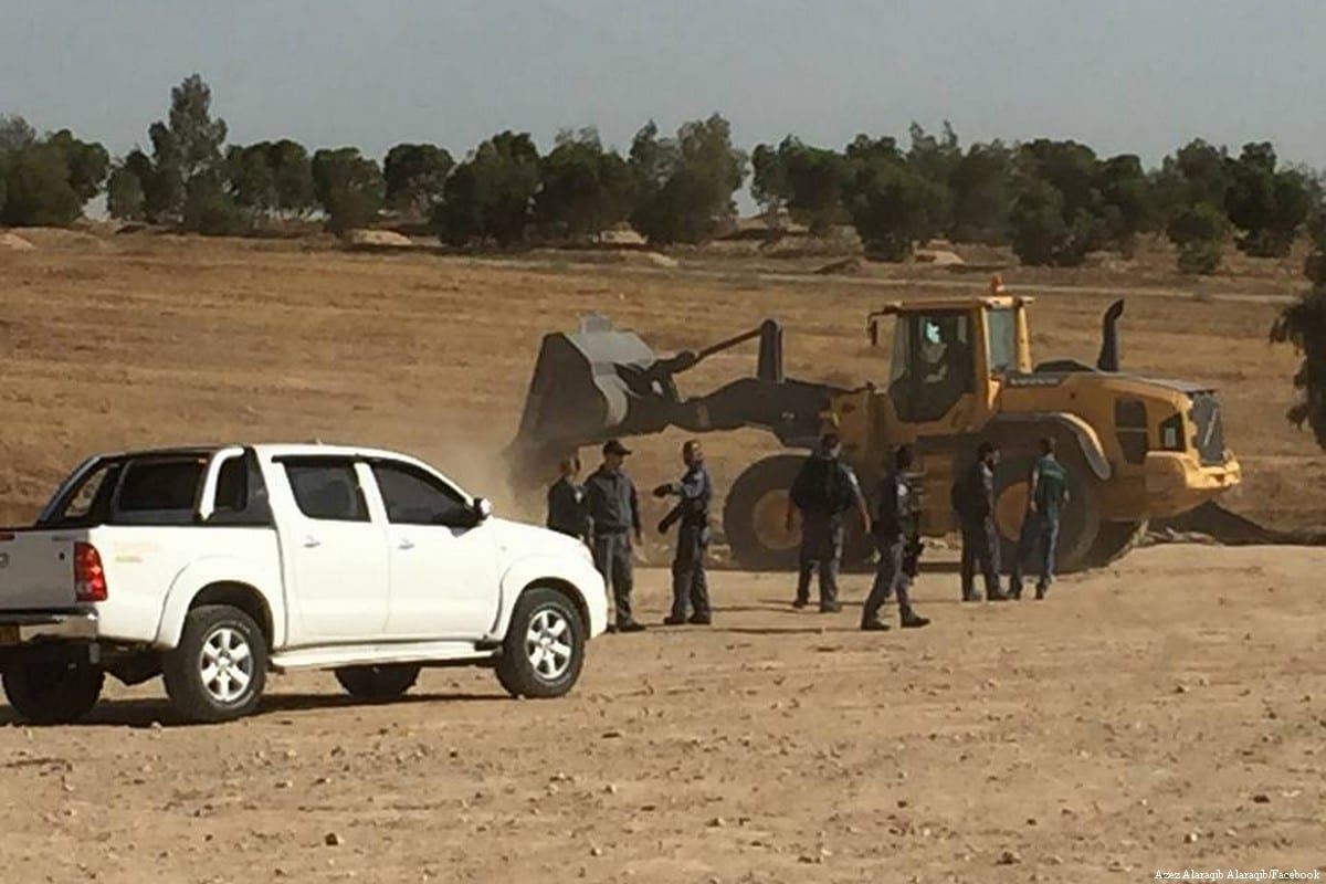 Israeli forces can be seen demolishing the Arab village of Al-Araqeeb in the Negev [Azez Alaraqib Alaraqib/Facebook]