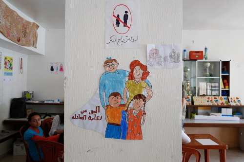 Drawings by young Syrian refugee girls in a community centre in southern Lebanon promote the prevention of child marriage [Wikipedia]