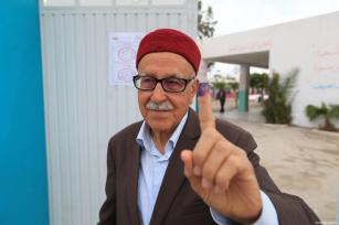 A man poses for a photo after casting his vote at a polling station during Tunisian local elections, which was held first time after 2011 Arab Spring revolution, in Ben Arous, Tunisia on May 06, 2018. ( Yassine Gaidi - Anadolu Agency )
