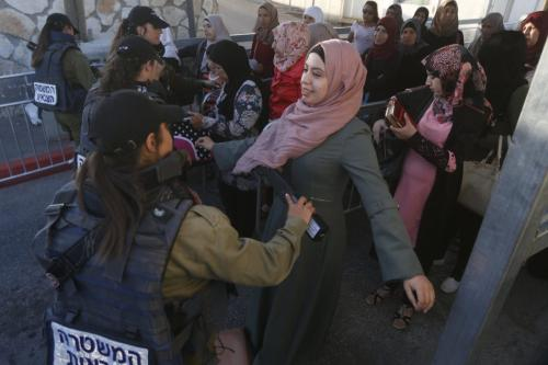 Thousands of Palestinians in the occupied West Bank began arriving in the holy city of Jerusalem on Friday for the first Friday prayers at the Al-Aqsa Mosque amid tight Israeli security measures [Wisam Hashlamoun/Anadolu Agency]
